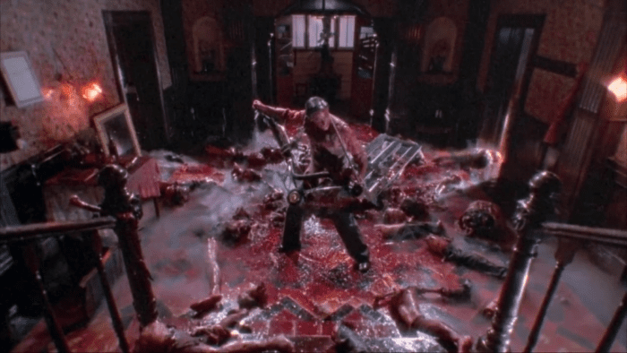 Lionel, with a lawnmower strapped to his chest is surrounded by blood and guts
