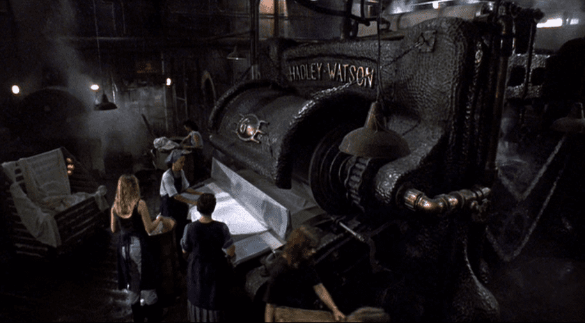 several characters look at the laundry press in the film The Mangler