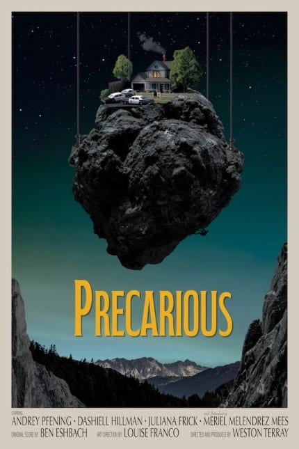 Poster for Precarious. A miniature house with policecars on the lawn is suspended by wires, the night sky and mountains in the background