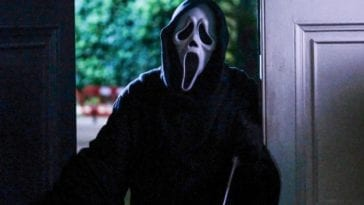 Ghostface stands in a doorway
