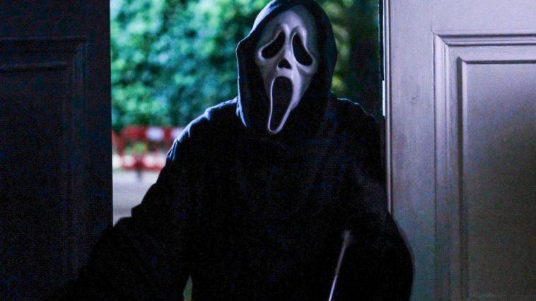 Ghostface stands in a doorway