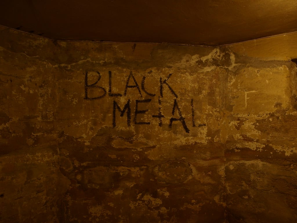 A shot of graffiti in Euronymous basement. Black Metal is scrawled on the wall.