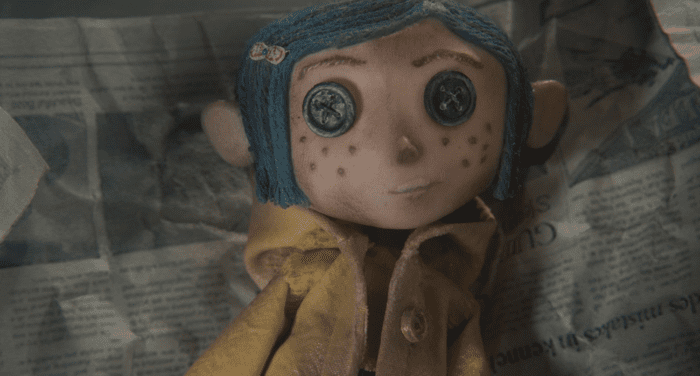 An exact replica doll of Coraline (except this one has button eyes), say on top of a piece of newspaper