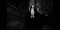 "Count Dracula (Béla Lugosi) holds one arm out in a beckoning welcome and holds a candle in the other hand in the film, ""Dracula"" (1931)."
