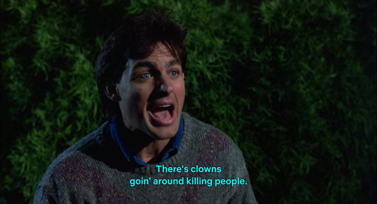 """Mike Tobacco (Grant Cramer) yells, """"There's clowns goin' around killing people,"""" in the film, """"Killer Klowns from Outer Space"""" (1988)."""