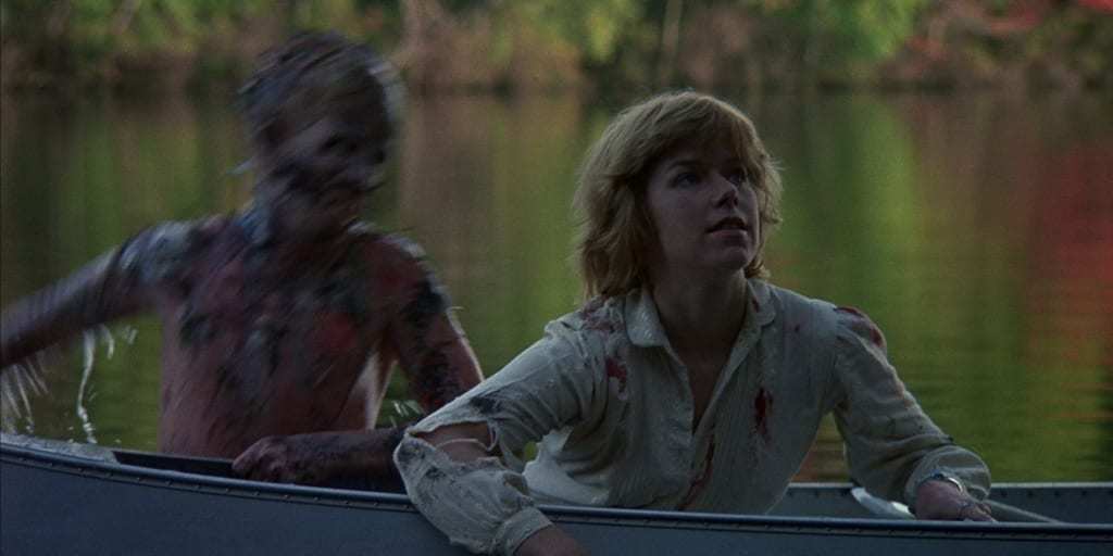 Jason Voorhees rises out of the water to grab Alice in Friday the 13th.