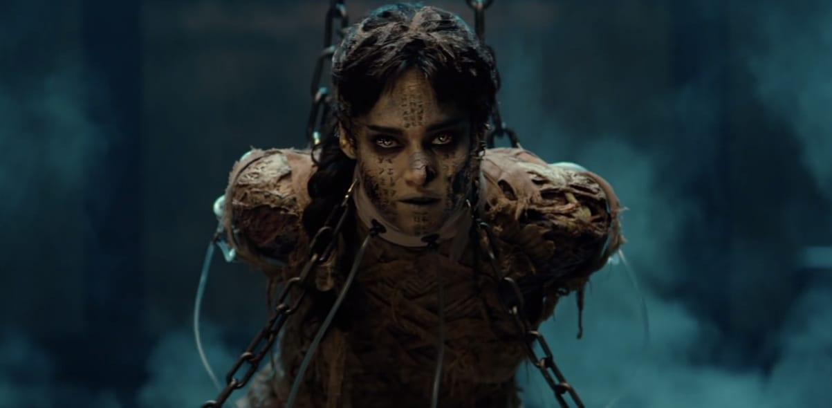The mummy chained up, suspended in air with a piercing stare, staring right into your soul.
