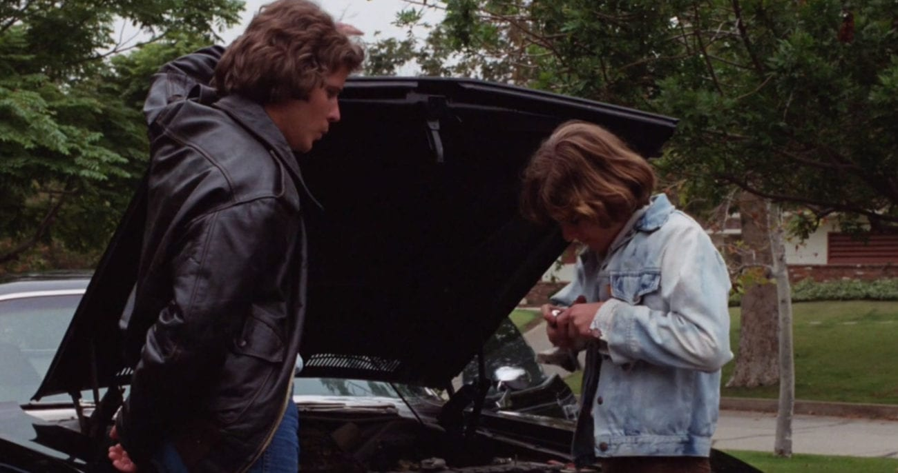 Brothers Mike and Jody work on the family car in the film Phantasm.
