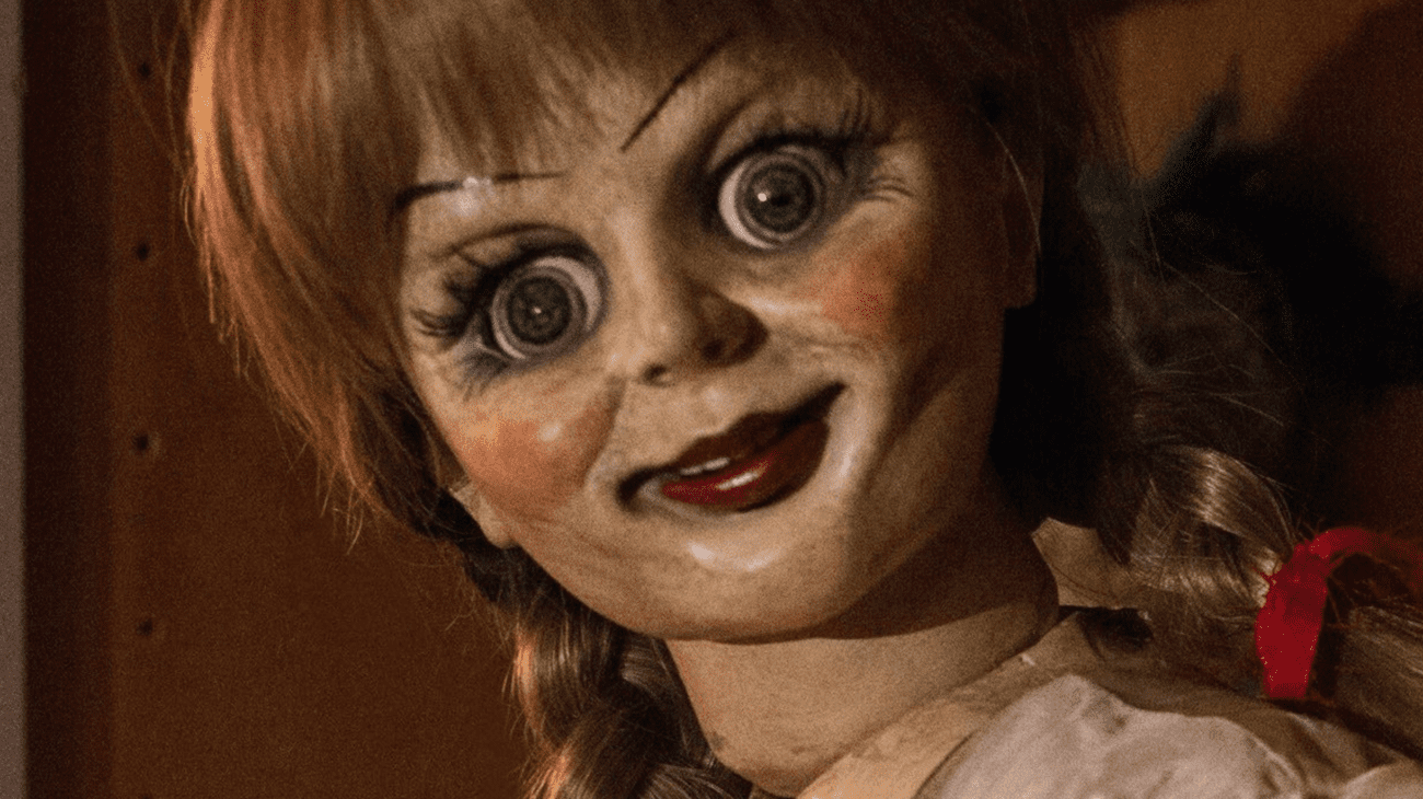 The Annabelle doll staring intently into the camera