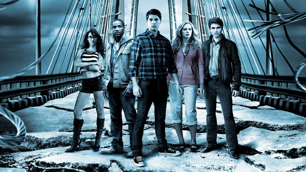 Still from the bridge sequence in the last film, the characters are posed in front of the bridge
