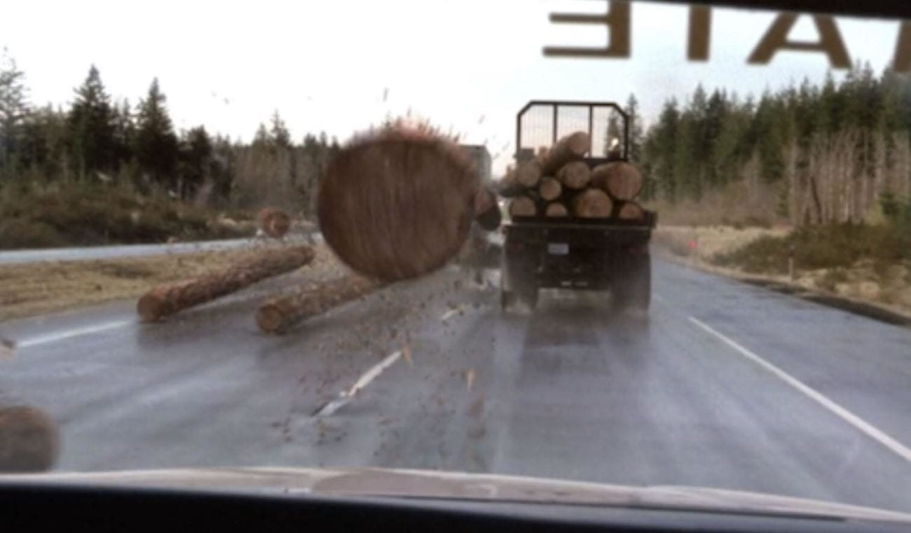 From the drivers point of view, a log has fallen from a truck ahead and is heading for your windscreen