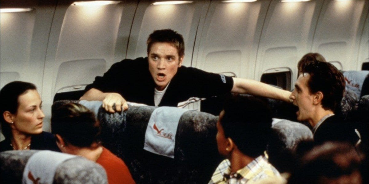 The characters from the first film starting to panic on the plane