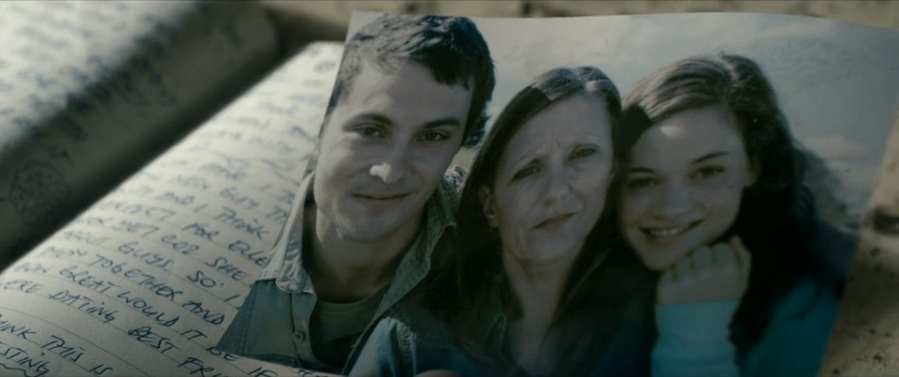 A photo of a happy family: a young man and woman and an older woman.