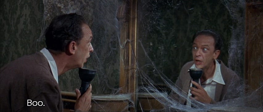 "Luther Heggs (Don Knotts) looks at his reflection with a flashlight under his face and says, ""Boo,"" in the film, ""The Ghost and Mr. Chicken"" (1966)."