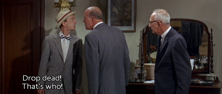 "Luther Heggs (Don Knotts) yells at Nicholas Simmons (Philip Ober), ""Drop dead! That's who!"", in the film, ""The Ghost and Mr. Chicken"" (1966)"