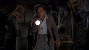 "Luther Heggs (Don Knotts) shines a flashlight in an old, cobweb-filled room, in the film, ""The Ghost and Mr. Chicken"" (1966)."