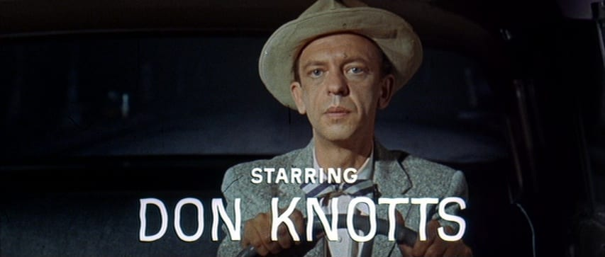 "Luther Heggs (Don Knotts) drives a car during a thunderstorm at night. Credits read, ""Starring Don Knotts,"" in the film, ""The Ghost and Mr. Chicken"" (1966)."