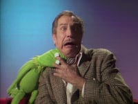 """Kermit the Frog bites Vincent Price on the neck vampire-style and Vincent Price yells in the TV show, """"The Muppet Show."""""""