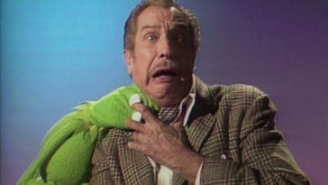 "Kermit the Frog bites Vincent Price on the neck vampire-style and Vincent Price yells in the TV show, ""The Muppet Show."""