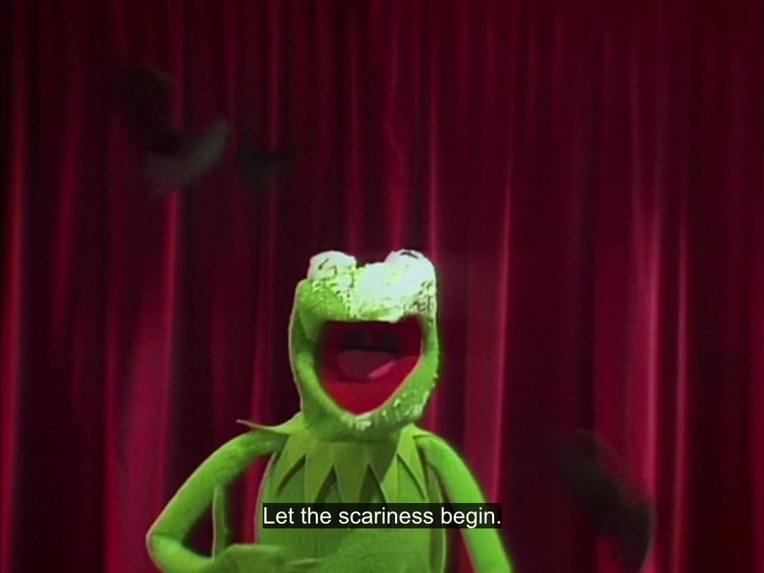 "Kermit the Frog, with leftover pie on his face and bats flying behind him, says, ""Let the scariness begin,"" in the TV show, ""The Muppet Show."""