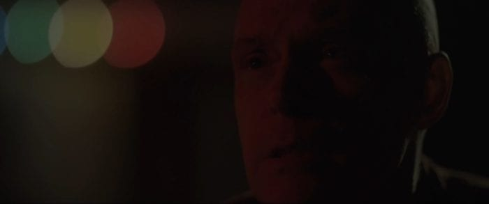 Cass looks into the night with tears rolling down his face