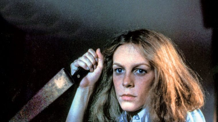 Laurie holds a knife, waiting for Michael to attack.