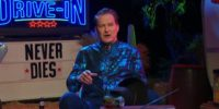 Joe Bob Briggs sitting on the set of The Last Drive-In