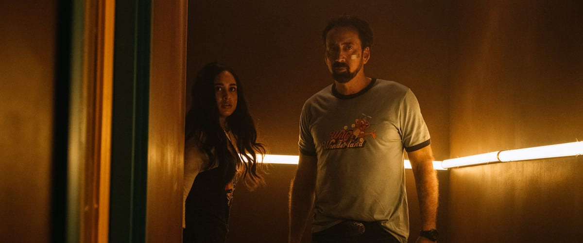 The Janitor and Liv looking concerned while standing in a dark hhallway.