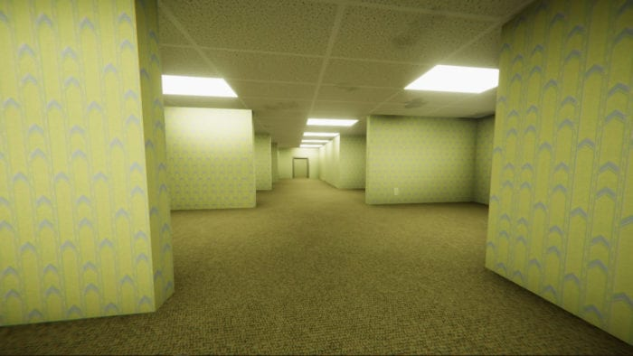 an endless series of hallways. the floor and walls are an off-yellow and bright lights dot the ceiling