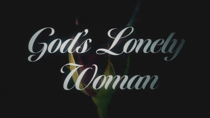 God's Lonely Woman text over a