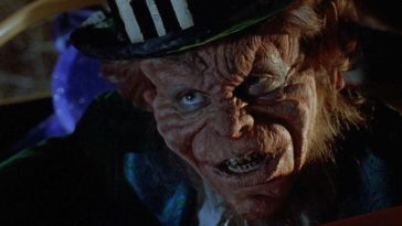 A Leprechaun stares intently with his sharp, dirty yellow teeth.