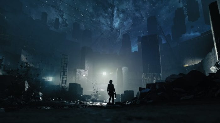 Jesse stands in a mining pit, the open sky full of stars and strange black monoliths