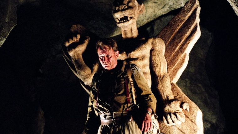 A man stands in front of an iconic demonic statue in The Exorcist prequel