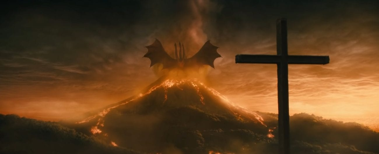 Ghidorah standing triumphantly on a volcano