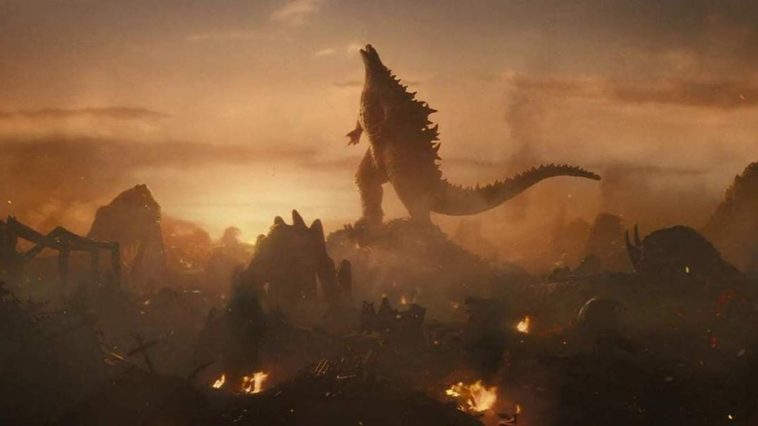 A triumphant Godzilla surrounded by other titans