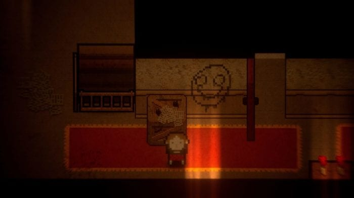 Claire stands in a dimly hit hallway. A drawing of a smiley face is on the wall behind her.