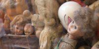 a pile of assorted porcelain dolls