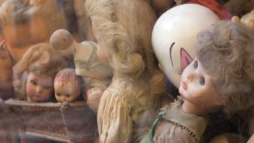 a pile of assorted porcelain dolls
