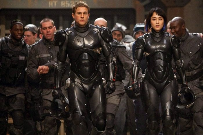 Jaeger pilots walking in front of a crowd