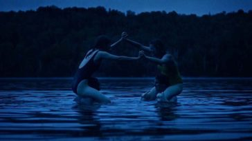 Two women sitting on two men's shoulders playfully fight in a lake in Violation