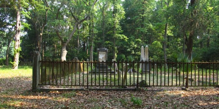 An old, fenced in cemetery in the woods of South Carolina's Lowcountry