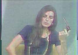 Christine Chubbuck displays a pistol just before shooting herself on television.