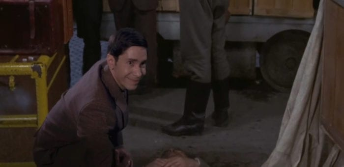 "Simon (Justin Long), chuckles while crouching near a dead body inside the film, ""Horror Express"" (1972), from the TV show, ""Creepshow."""