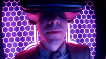"Simon (Justin Long) sits inside his invention, the Immersopod, for a virtual reality experience, from the TV show, ""Creepshow."""
