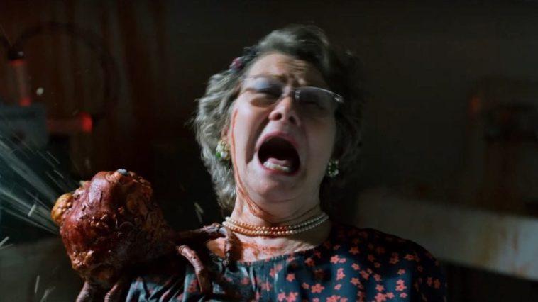 Della screams as the Cyst exudes fluids on her shoulder
