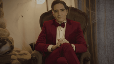 David Dastmalchian sits and prepares for his hosting duties