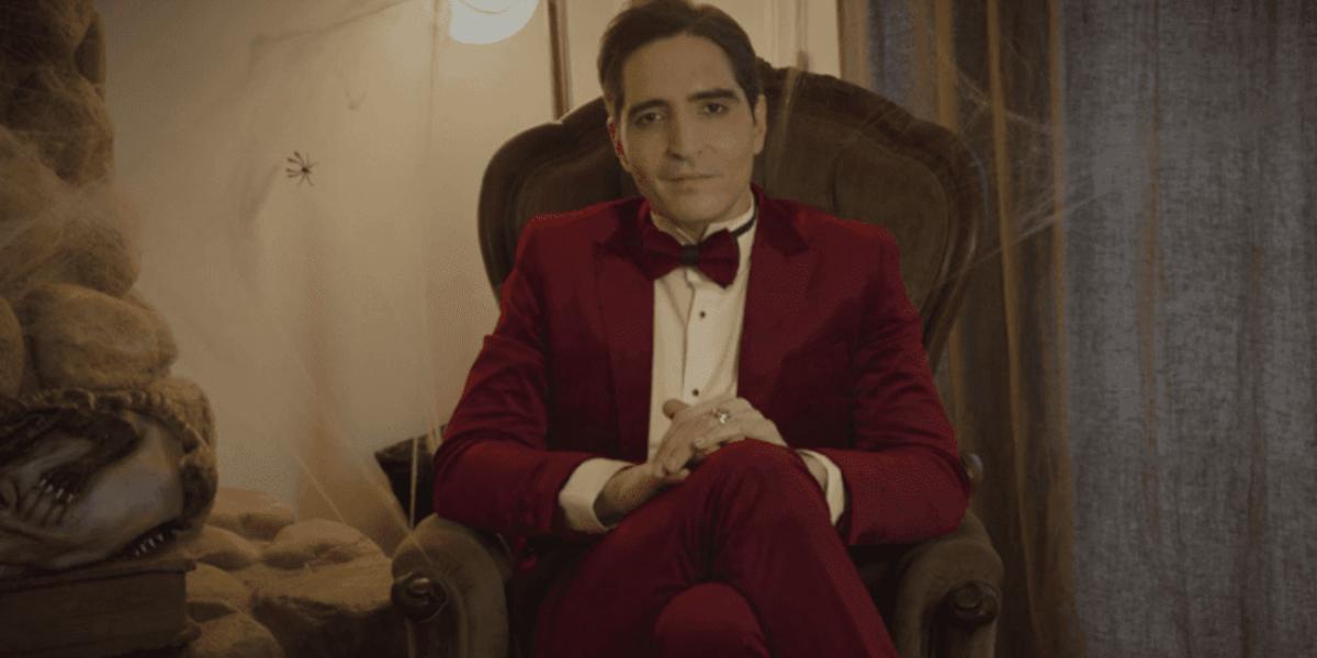 David Dastmalchian sits and prepares for his hosting duties