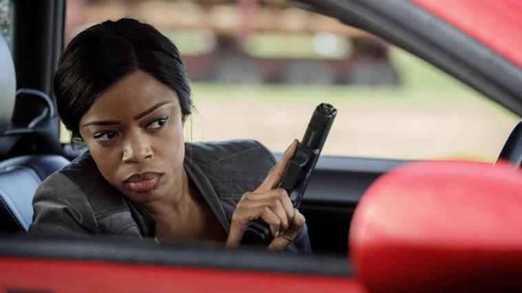 Detective Amanda Fisher holds a gun in Ash vs. Evil Dead