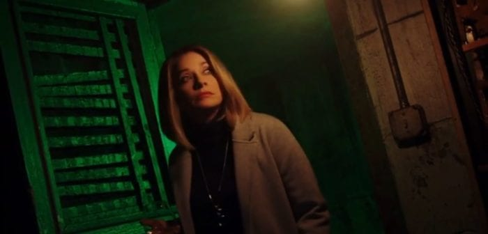 Victoria enters a room filled with green light.