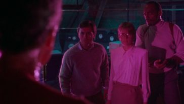 Crawford, Katherine and Bubba stand under pink light. Dr. Pretorius stands with his back to the camera